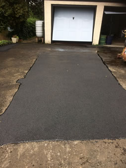 Tarmacadam patch repair Driveways after